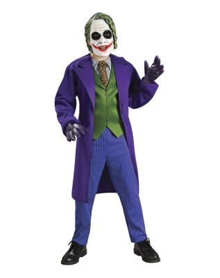 boy wearing a joker costume for halloween