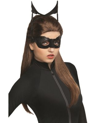 a girl wearing a catwoman mask and wig