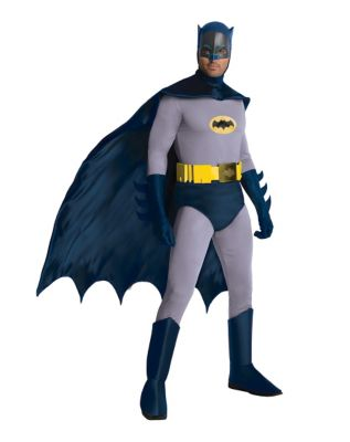 a man wearing a classic batman outfit