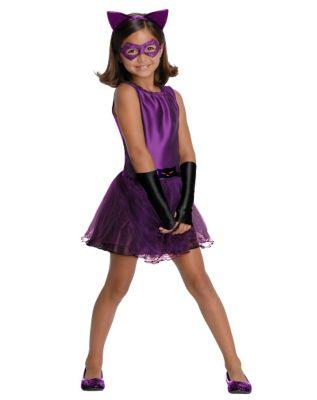 a girl wearing a purple tutu